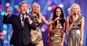 Terry Wogan with (left to right) Tess Daly, Alesha Dixon and Fearne Cotton during the BBC Children In Need Appeal of 2011. Photograph: PA