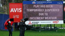 A sign announces that play has stopped for a rain delay on the final round of the Farmers Insurance Open golf tournament at Torrey Pines in San Diego. Photo: KC Alfred/PA