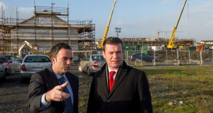 Minister for the Environment Alan Kelly with TD John Lyons visiting the site of a modular housing project at Balbutcher Lane, Poppintree, Ballymun, Dublin. Photograph: Dara Mac Dónaill/The Irish Times