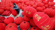 A worker makes lanterns at a factory ahead of the upcoming Chinese Lunar New Year. Photograph: REUTERS/China Daily