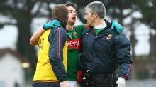 Lee Keegan is helped from the field by selector Tony McEntee and team doctor Seán Moffatt after a clash of heads with Cork's Eoin Cadogan during Sunday's football league clash. Photograph: James Crombie/Inpho