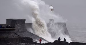 Waves crash over the lighthouse at Porthcawl, Wales, February 1, 2016. Gale force winds are affecting parts of Wales. REUTERS/Rebecca Naden