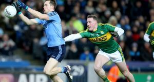 Dublin's Dean Rock with Mark Griffin of Kerry in Croke Park on Saturday night. Photograph: Inpho