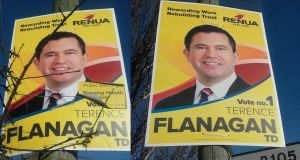 "A poster for Renua's Terence Flanagan has had its ""public meeting"" sticker begin to peel off in the wind (left), while other posters have seen the stickers removed completely (right). Photographs: Stephen Ray"
