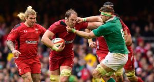 CARDIFF, WALES - MARCH 14: Ireland player Jamie Heaslip gets to grips with Alun Wyn Jones of Wales during the RBS Six Nations match between Wales and Ireland at Millennium Stadium on March 14, 2015 in Cardiff, Wales. (Photo by Stu Forster/Getty Images)