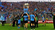 Dublin footballers celebrate their third All-Ireland victory in five years at Croke Park last September. Photograph: Donall Farmer/Inpho