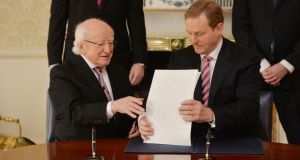 Taoiseach Enda Kenny with President Michael D Higgins at Áras an Uachtaráin where they signed the dissolution of the 31st Dail. Photograph: Alan Betson / The Irish Times