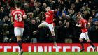 Wayne Rooney scored Manchester United's third in their 3-0 win over Stoke City. Photograph: Reuters