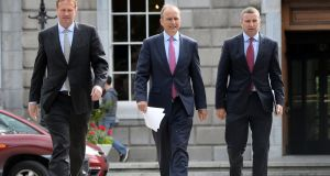 Fianna Fáil leader Micheál Martin  (centre) with Jim O'Callaghan SC (left) legal advisor and justice spokesperson Niall Collins at Leinster House in Dublin. Photograph: Eric Luke/The Irish Times