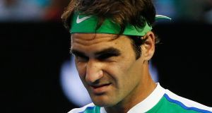 Roger Federer faces a month out after injuring his knee the day after his Australian Open defeat to Novak Djokovic. Photograph: Reuters