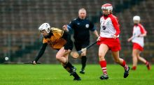 Killimor's Susan Keane in action against Emma McFadden of Loughgiel in the AIB All-Ireland senior camogie club championship semi-final at Clones. Photograph: Donall Farmer/Inpho