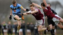 UCD sub  Conor McCarthy scores a point  despite the attempts of NUIG's Kevin McDonnell and David Murray during the  Sigerson Cup game at  Dangan. Photograph:  Seb Daly/Sportsfile