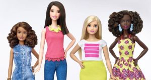 The new petite, tall and curvy Barbies standing next to her traditional tiny-waisted, pin-legged figure. Photograph: Mattel/Reuters