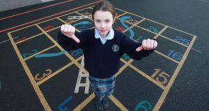 Lucille O'Mahony, a third-class pupil of Guardian Angels National School, Blackrock, Co Dublin, is leading a campaign against the rule that girls must wear skirts. Photograph: Nick Bradshaw