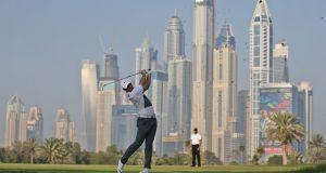 Rory McIlroy plays a shot during the first round of the Omega Dubai Desert Classic at the Emirates Golf Club in Dubai. Photograph: Photograph: Ali Haider/EPA