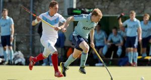 Monkstown's Gareth Watkins  and Lisnagarvey's James Lorimer in action. Photograph: Donall Farmer/Inpho