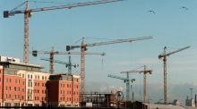 "Cranes on the Dublin skyline. ""One key point to recall in this panorama is that every single promise made on the hustings is predicated on a continuation of growth in Ireland, which itself depends on world growth."""