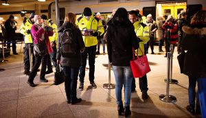 Security staff check commuters' identification  at the train station at Kastrup airport in Copenhagen,  the last Danish stop before Sweden. Photograph: Nils Meilvang/AFP/Getty Images)