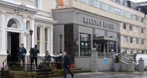 Gardai at the scene of the  shooting at the Regency Hotel in Dublin. Photograph:   Collins