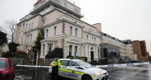 A Garda cordon outside the Regency Hotel in Dublin where one man was shot dead   and two others were injured. Photograph: PA