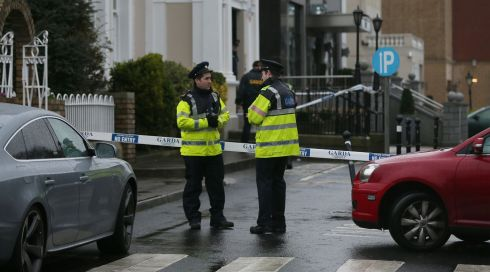 Gardai confer outside the Regency Hotel in Dublin after one man died and two others were injured following a shooting incident at the hotel. Photograph: Niall Carson/PA Wire