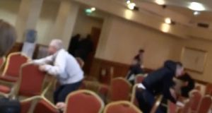 A still from a video taken as shots were fired at a boxing weigh-in at a Dublin hotel this afternoon. One man was killed and two others injured in the attack. Image: Storyful