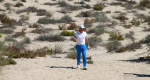 Rory McIlroy finished strongly to post a third round 68 in Dubai. Photograph: Afp