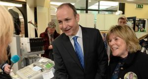 Fianna Fáil leader Micheál Martin is seen while canvassing with local candidate Mary Butler in Waterford on Thursday.  Photograph: Frank Miller/The Irish Times