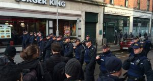 The stand-off involving members of the Garda Public Order Unit and demonstrators  on Cathedral Street. Photograph: Cyril Byrne