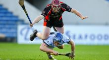 Na Piarsaigh's Mike Casey is tackled by Oulart-The Ballagh's Nicky Kirwan. Photograph: Inpho
