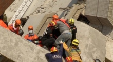 Taiwan earthquake: survivor pulled from rubble