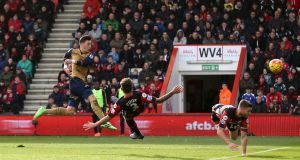 Mesut Özil scores Arsenal's  first goal during the Premier League game against Bournemouth at  Vitality Stadium. Photograph:  Matthew Childs/Action Images via Reuters
