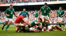 Ireland scrumhalf Conor Murray  crashes through the tackle from Justin Tipuric of Wales to score the opening try during the RBS Six Nations match  at the Aviva Stadium. Photograph:  Stu Forster/Getty Images