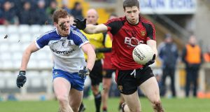 Shay McArdle of Down and Kieran Duffy of Monaghan during their Allianz League Division One match. Photo: Andrew Paton/Inpho