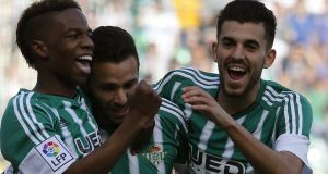 Real Betis' striker Ruben Castro celbrates with his team mates after his strike gave them a win over Valencia in La Liga. Photo: Jose Manuel Vidal/PA