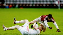 Pat McGeary of Tyrone and Daithi O'Gaoithin of Galway tangle during the sides' Allianz League Division Two clash. Photo: Keith Wiseman/Inpho