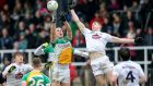 Kildare's Daniel Flynn and Graham Guilfoyle of Offaly contest a high kickout during their Allianz League Division Three clash. Photo: Cathal Noonan/Inpho