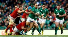 "Simon Zebo tries to break free from Welsh tacklers at Aviva Stadium. ""Scotland wax lyrical at their man Stuart Hogg but Zebo has better lines and given more opportunity can cut any defence apart."" Photograph: James Crombie/Inpho"