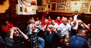 Welsh and Irish fans show the tension of the last moments of the drawn Six Nations game in the Palace Bar, Dublin. Photograph: Cyril Byrne/The Irish Times