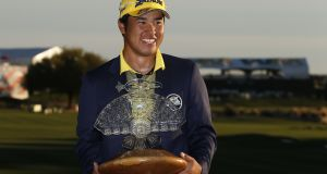 Hideki Matsuyama of Japan poses with the  trophy  after winning the  Phoenix Open at TPC Scottsdale  in  Arizona. Photograph: Christian Petersen/Getty Images