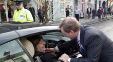 Enda Kenny talks to a voter during an election visit to Ballina. Photograph: Anthony Hickey