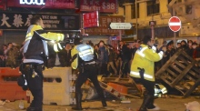 Police and vendors clash in violent Hong Kong riots