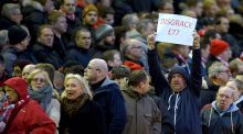 Liverpool fans walked out in the 77th minute as a protest over an increase in ticket prices at Anfield. Photograph: EPA