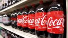 Coca-Cola Co reported an 8 per cent fall in quarterly net revenue, as a strong dollar once again reduced the value of sales from outside the United States. (Photograph: Lucas Jackson/Reuters)