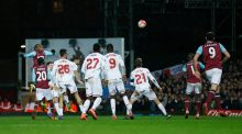 West Ham's Angelo Ogbonna rises above the Liverpool defence to head home the winning goal in the FA Cup fourth-round replay in extra-time at Upton Park. Photograph:  Eddie Keogh/Reuters/Livepic