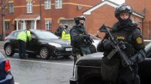 Gardaí from the Emergency Response Unit on patrol in north  Dublin yesterday. Photograph: Niall Carson/PA Wire