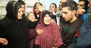 The mother (centre), friends and relatives of Omar Maddi, at  al-Mizan hospital in the West Bank city of Hebron. Photograph: Hazem Bader/AFP/Getty Images