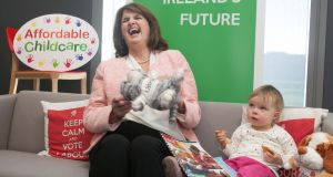 Tánaiste Joan Burton and Abi Boxshall (2), from Lucan, at the  launch of Standing Up For Families, Labour's plan for quality and affordable childcare. Photograph: Gareth Chaney/Collins