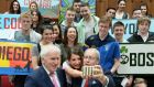 Student Faoiltiarna Keenan from Tyrone (centre) with  US ambassador Kevin O'Malley (right) and Minister for the Diaspora Jimmy Deenihan taking a selfie at a Usit and CIEE (Council of International Educational Exchanges) orientation session at UCD  for J-1 participants  in 2015. File photograph: Dara Mac Dónaill/The Irish Times