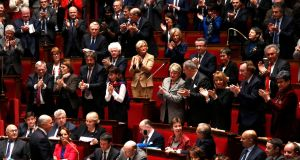 French foreign affairs minister Laurent Fabius (bottom left) reacts as deputies applaud  at the National Assembly in Paris on Wednesday.  Photograph: Charles Platiau/Reuters